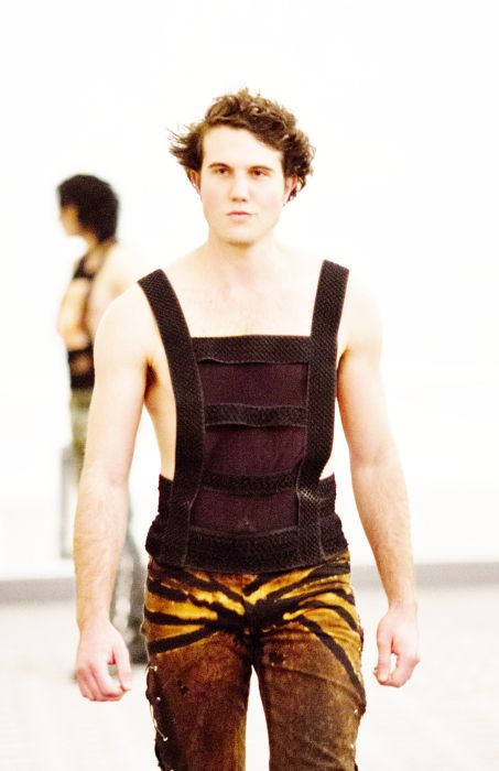 Shapewear in a tank top that cinches in love handles and exposes skin in the most flattering manly areas.