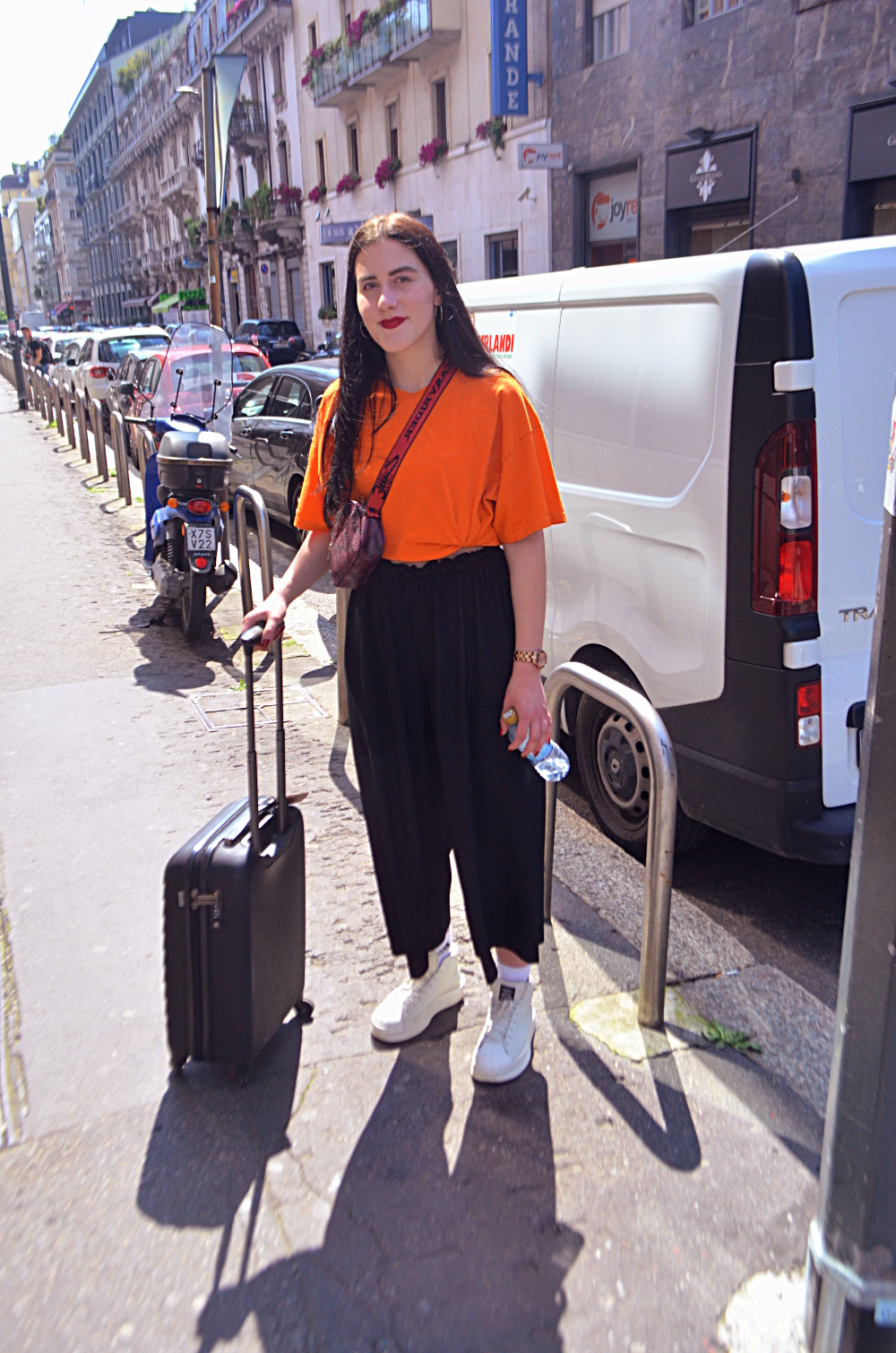 Look at how cool these oversized cropped pants look with the pop of orange and white hightops. This chica was so cool to talk to Cal says.