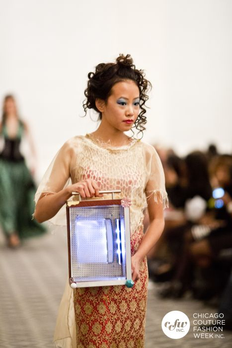 An Asian Royalty in a j-na couture cultural fusion with a Corso Light Sculpture. Runway Inspiration.