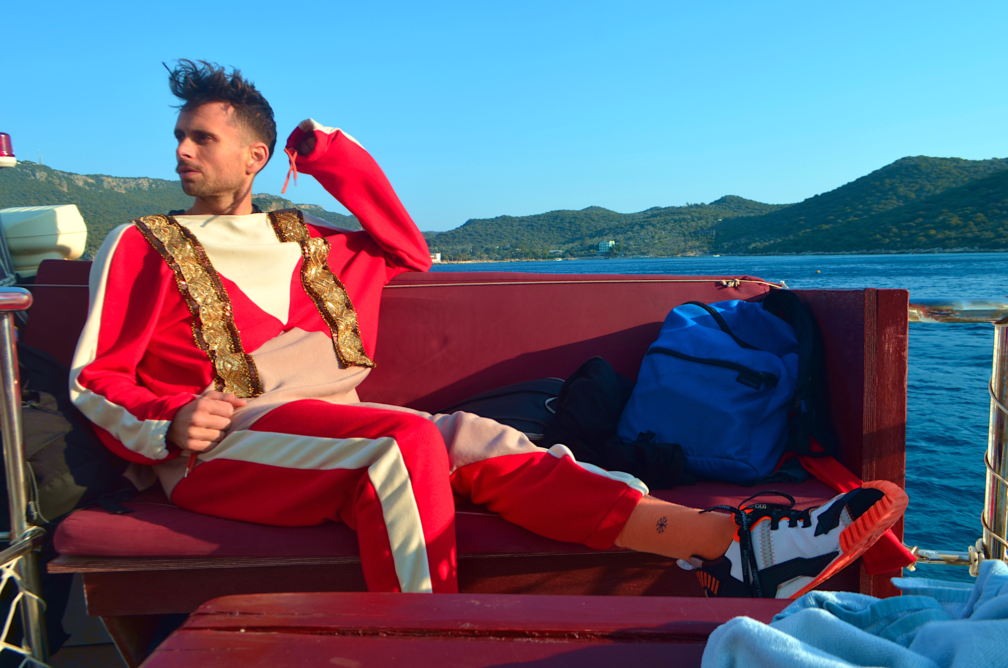 Caleb Garcia Taylor in his matching loungewear sets design: King of Diamonds on a boat in the Mediterranean sea.