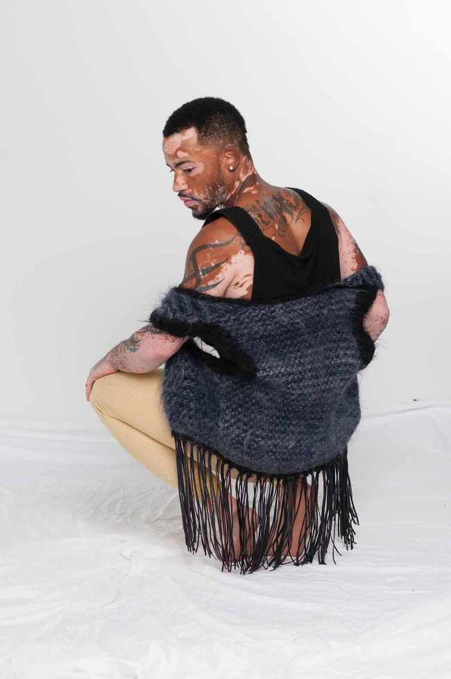 The alpaca handknit couture vest with leather fringe helps you celebrate you, as demonstrated by vitilio model.