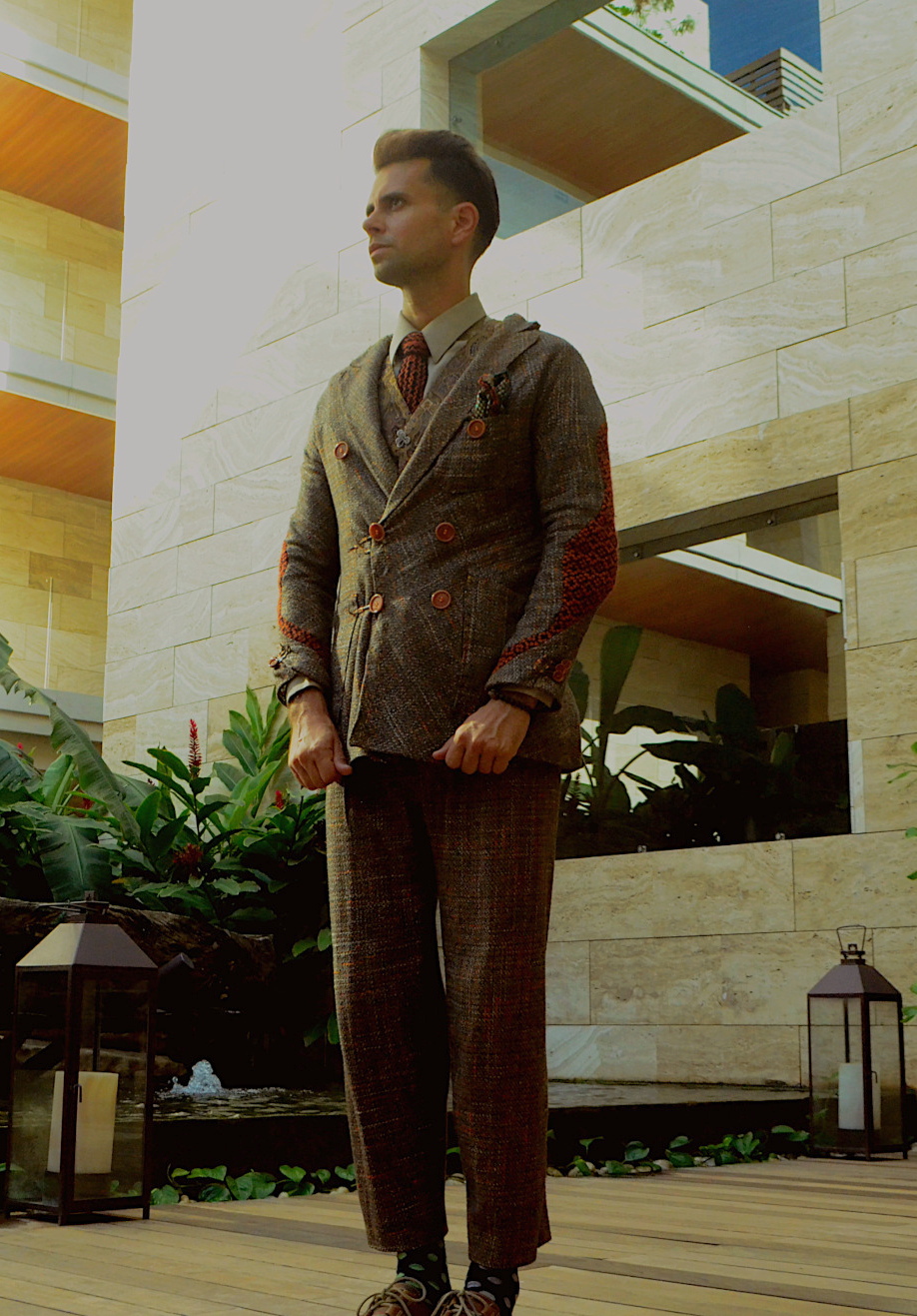 Bespoke wool and silk suit with a creative cut and interesting design features via GSb wearables.