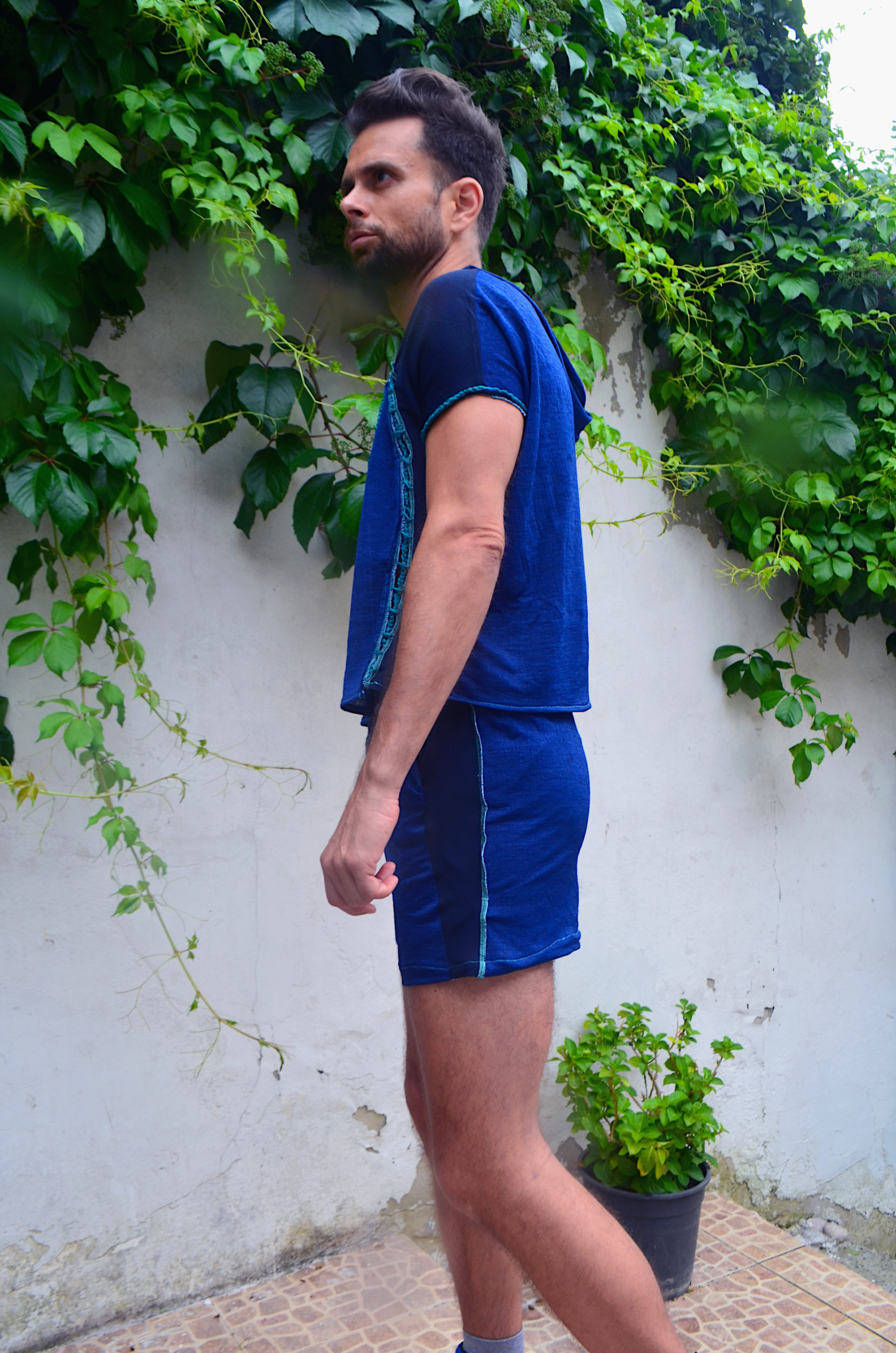 Color blocked superman blue summer loungewear jogger set by Caleb Garcia Taylor with crochet cut-outs.