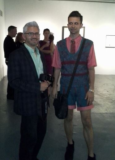 Designer Cal Garcia in his couture Euro Euro Style knit wear at art expo in Chicago with Chicago Curator Sergio Gomez.