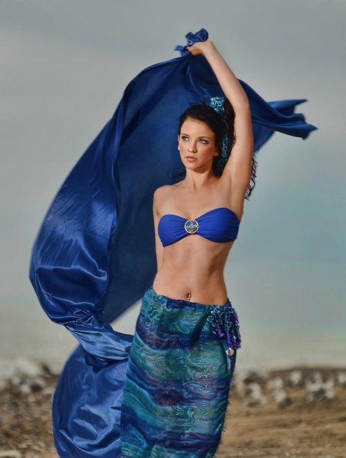 j-na beach sarong with shell adornment.