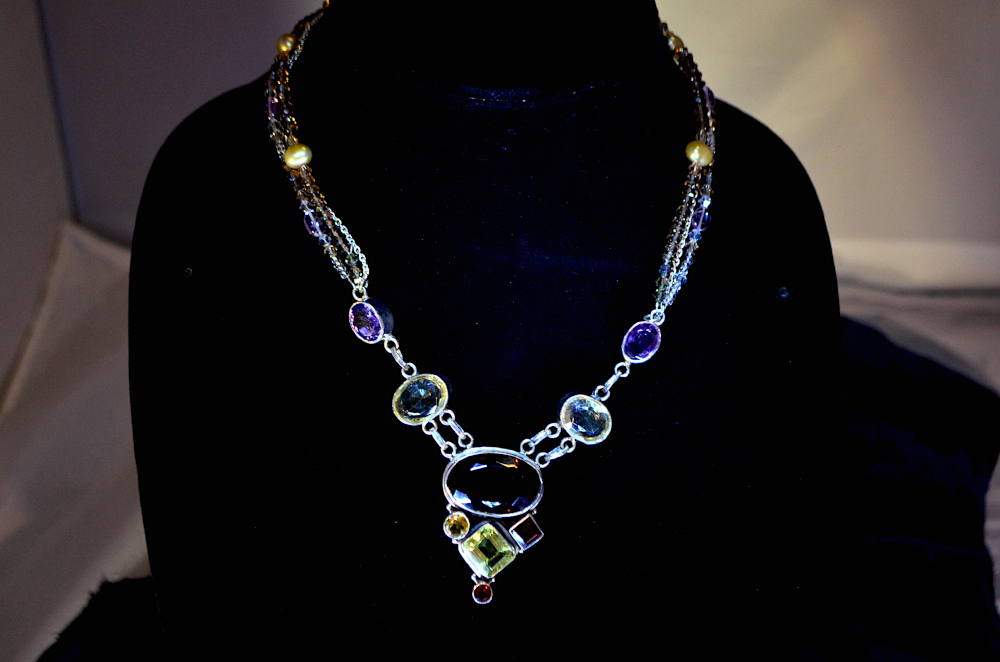 Semi-precious large  gemstone timelessness wholeness offset in silver necklace. A uniquid original piece from J-na Couture.