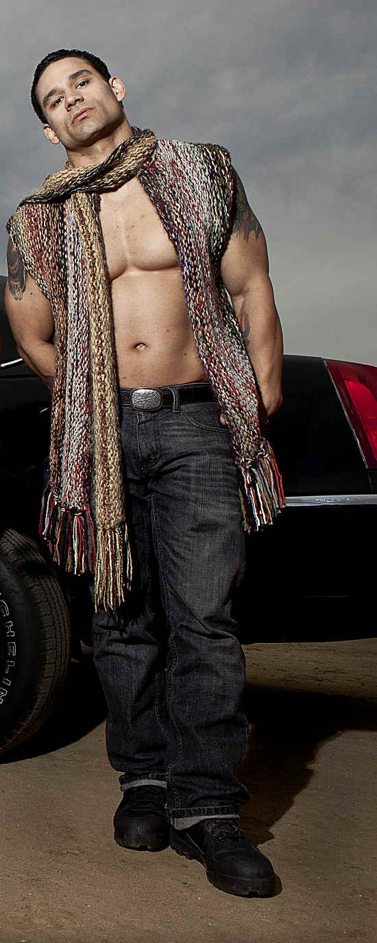 Men's hand knit scarf with a ruggend edgy look done high fashion.