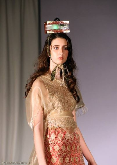 j-na couture runway with Art objects from Corso Studios. Couture Head-pieces.