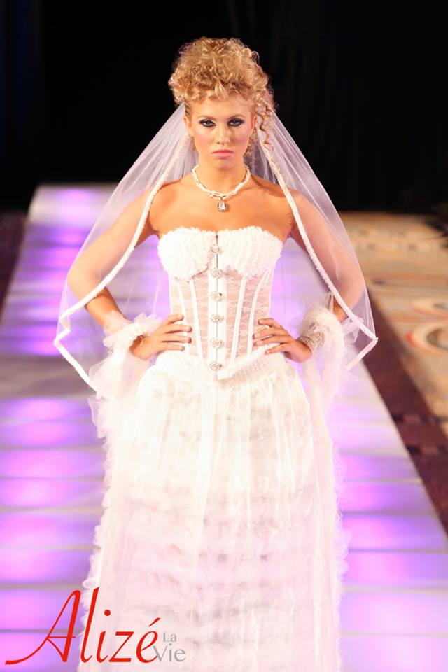 Runway Ready Bride Chanel Parisian Inspired woven tulle corset gown embedded with the lastest advances in wearable technology debutes at Couture Fashion Week during New York Fashion Week.