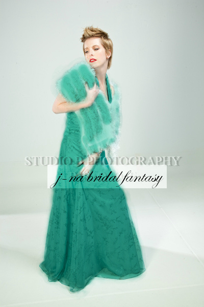j-na faux fur and feather bridal cape in teal.