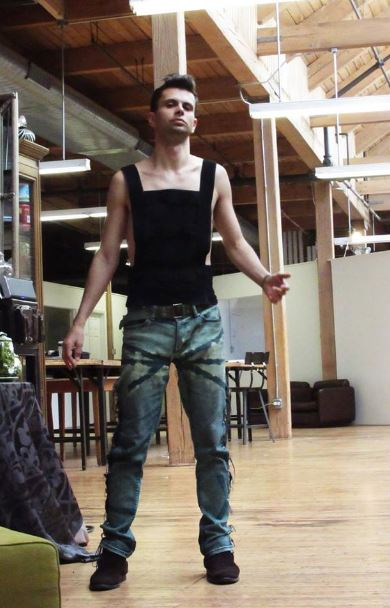 Comfortable Cal Garcia in his favorite Green Eco-Couture Jeans in the Designer Studio Loft. Here we also see the form-fitting couture tank top with semi-sheer blocks.