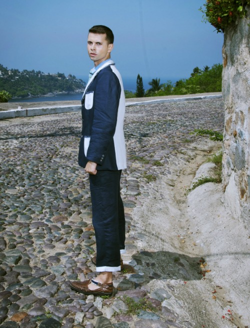 Two tone linen suit in blues highwater slacks and loafers with fur fringe.