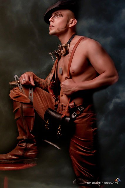 Danish steampunk designer with rubber suspenders and messenger bag.